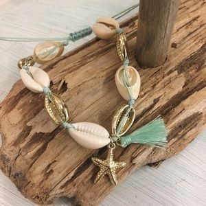 Cowry shell adjustable gold bracelet